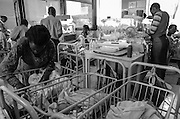 Bea Ahbeck/Fremont Argus<br /> <br /> Mothers care for their premature babies in the preemie ward at Mulago Hospital in Kampala, Uganda, Nov. 7, 2005. Most of them are staying at the hospital, and come in every two hours to feed their infants.