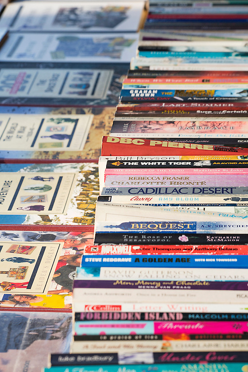 A selection of second hand books  lined up on a table at the market in central London