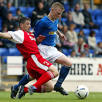 St Johnstone v Brechin City....30.08.03<br />Mark Baxter is tackled by Ally Mitchell<br /><br />Picture by Graeme Hart<br />Perthshire Picture Agency<br />Tel: 01738 623350 / 07990 594431