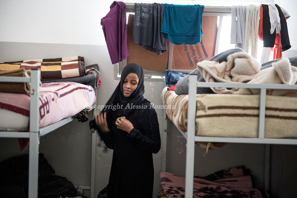Libya, Misurata: An Eritrean woman who claims to have being used as sex slaves by ISIS member in Sirte is seen inside her cell at the Libyan airforce compound in Misurata. Alessio Romenzi