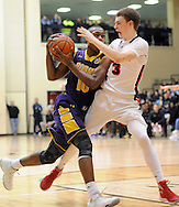 SPLYM16P<br /> Roman Catholic's Tony Carr #10 drives to the basket as Plymouth Whitemarsh's Oakley Spencer #3 defends in the second quarter of a semifinal playoff game Monday March 15, 2016 at Council Rock South High School in Richboro, Pennsylvania. (William Thomas Cain/For The Inquirer)