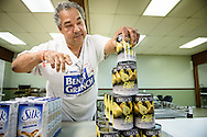 Broadmoor Food Pantry volunteer Ronnie Seaton, Sr., works in the pantry next to Gloria Dei Lutheran Church on Wednesday, March 9, 2016, in New Orleans. Seaton, who is nearly blind and diabetic, started attending Gloria Dei after hearing the Lutheran doctrine. LCMS Communications/Erik M. Lunsford