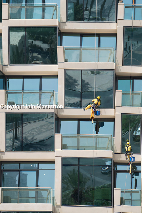 Detail of windows and balconies and window cleaners on new high rise apartment building in Downtown Dubai, UAE, United Arab Emirates.