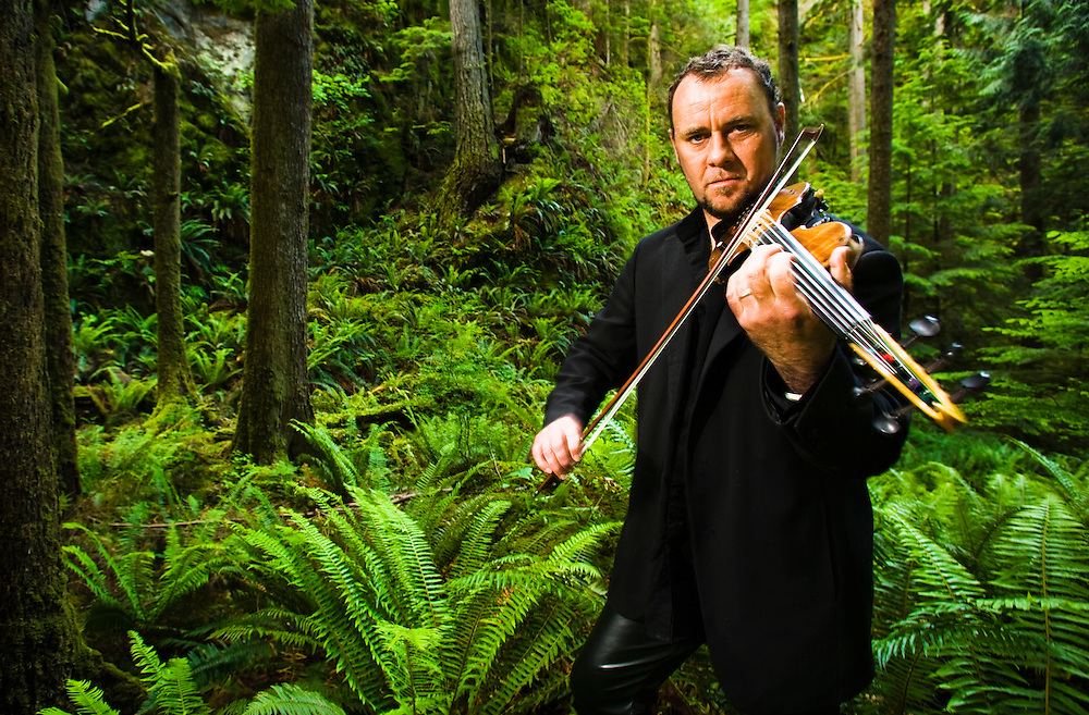 Portrait of violinist, Geoffrey Castle in a moss and fern covered forest.  Along the Little Si trail near Northbend, Washington, USA.