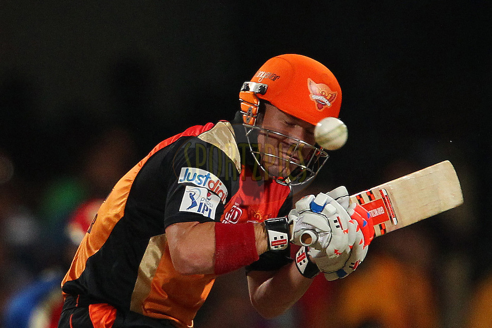 David Warner of the Sunrisers Hyderabad avoids a bouncer from Varun Aaron of the Royal Challengers Bangalore during match 24 of the Pepsi Indian Premier League Season 2014 between the Royal Challengers Bangalore and the Sunrisers Hyderabad held at the M. Chinnaswamy Stadium, Bangalore, India on the 4th May  2014<br /> <br /> Photo by Ron Gaunt / IPL / SPORTZPICS<br /> <br /> <br /> <br /> Image use subject to terms and conditions which can be found here:  http://sportzpics.photoshelter.com/gallery/Pepsi-IPL-Image-terms-and-conditions/G00004VW1IVJ.gB0/C0000TScjhBM6ikg
