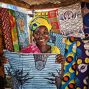 29/10/2019 / Garu / Ghana:<br /> Felicia goes to the market in Garu to shop for fabric she'd like to sew for Christmas.<br /> <br /> Oxfam built a solar powered pump in Kpatua to help over families become more resilient during dry seasons. Apart from community members coming to the pump twice a day, all year round, during the dry season, women use the water from the pump to farm vegetables for sale.