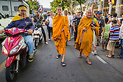 27 NOVEMBER 2013 - BANGKOK, THAILAND: Buddhist monks lead a group of protestors into the Ministry of Finance in Bangkok. There is still no sign of police or security personnel at the ministry and there has been no effort to expel protestors. Anti-government protestors continue to occupy the Ministry of Finance in Bangkok. Protests also spread to other government ministries and several provinces in southern Thailand, a stronghold of the opposition.     PHOTO BY JACK KURTZ