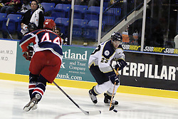 11 November 2006: Tyler Rennette steers the puck around Dale Lupul.&#xD;The Elmira Jackals met the Bloomington PrairieThunder at the U.S. Cellular Coliseum in Bloomington Illinois.<br />