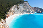 Sky blue water in big cliff bay
