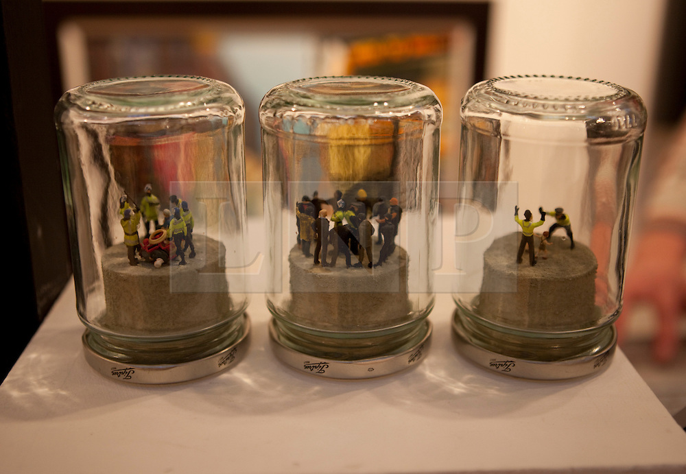 © Licensed to London News Pictures. 19/04/2012. London, U.K..Artwork by James Cauty 'riot in a jam jar' series at the Lilith Gallery section..The Setting up of The Chelsea Art Fair in Chelsea Old Town Hall where Around 35 galleries and dealers offer modern British and contemporary art for sale, including paintings, drawings, etchings and sculptures. Represents 500 international artists, with art worth up to £20k. The fair runs from 19th April - 22nd April..Photo credit : Rich Bowen/LNP