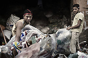 "Zabbaleen collectors storing different types of plastic in the neighborhood of Mokattam. On the outskirts of Cairo in the middle of Manshiet Nasr neighborhood is located Mokattam settlement known as ""Garbage City"" is inhabited by Zabbaleen, a community of about 45,000 Coptic Christians living for decades to recycle waste generated by the Egyptian capital: plastic, aluminum, paper and organic waste transformed into compost. Most part of the Association for the Protection of the Environment (APE), an NGO that works in the area, whose objectives are to protect the environment and improve the livelihoods of garbage scavengers in Cairo. According to the UN, the work is done in Mokattam is one of the ten best examples of world environmental improvement. El Cairo , Egipt, June 2011. ( Photo by  Jordi Camí )."