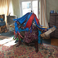 Mongolia. Ulaanbaatar. Mrs Batzaya Otgonzaya, young woman shaman during  a shamanic ceremony in a house  of the yurt area Ulaan baatar