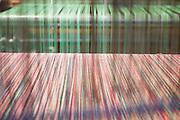 Soveria Mannelli (CZ) - Lanificio Leo. Particolare dell'ordito montato sul uno dei numerosi telai presenti nel Lanificio Leo.