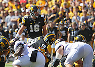 September 29 2012: Iowa Hawkeyes quarterback James Vandenberg (16) at the line during the first quarter of the NCAA football game between the Minnesota Golden Gophers and the Iowa Hawkeyes at Kinnick Stadium in Iowa City, Iowa on Saturday September 29, 2012. Iowa defeated Minnesota 31-13 to claim the Floyd of Rosedale Trophy.