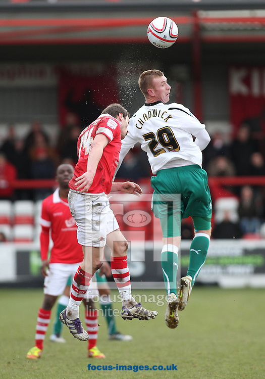 Picture by MIchael Sedgwick/Focus Images Ltd. 07900 363072.18/02/12.Kevin McIntyre of Accrington Stanley and Nick Chadwick of Plymouth Argyle in action during the Npower League 2 match at the Crown Ground, Accrington.