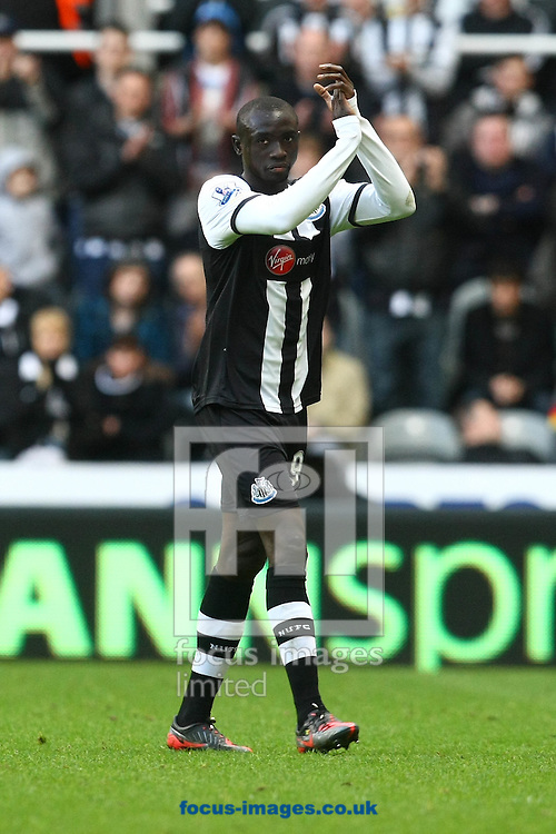 Picture by Paul Chesterton/Focus Images Ltd.  07904 640267.18/03/12.Papiss Cisse of Newcastle applauds the fans as he is substituted during the Barclays Premier League match at St James' Park Stadium, Newcastle.
