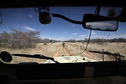 NAMIBIA GROOTFONTEIN 2MAY14 - Farmer Martinus van Blerk sports his rifle on the Omega farm near Grootfontein, Namibia.<br /> <br /> The farm holds about 700 hear of cattle, mostly Brahman-Charolais cross breeds. <br /> <br /> <br /> <br /> jre/Photo by Jiri Rezac<br /> <br /> <br /> <br /> &copy; Jiri Rezac 2014
