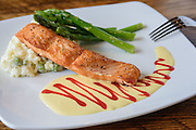 The Salmon with citrus sauce, risotto and asparagus at Somewhere restaurant at 1135 Bardstown Road, next to Nowhere bar. July 26, 2016