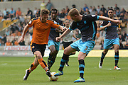 Sheffield Wednesday defender Michael Turner tackles Wolverhampton Wanderers midfielder James Henry during the Sky Bet Championship match between Wolverhampton Wanderers and Sheffield Wednesday at Molineux, Wolverhampton, England on 7 May 2016. Photo by Alan Franklin.