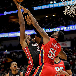 Dec 16, 2018; New Orleans, LA, USA; Miami Heat center Hassan Whiteside (21) shoots over New Orleans Pelicans guard E'Twaun Moore (55) during the first half at the Smoothie King Center. Mandatory Credit: Derick E. Hingle-USA TODAY Sports