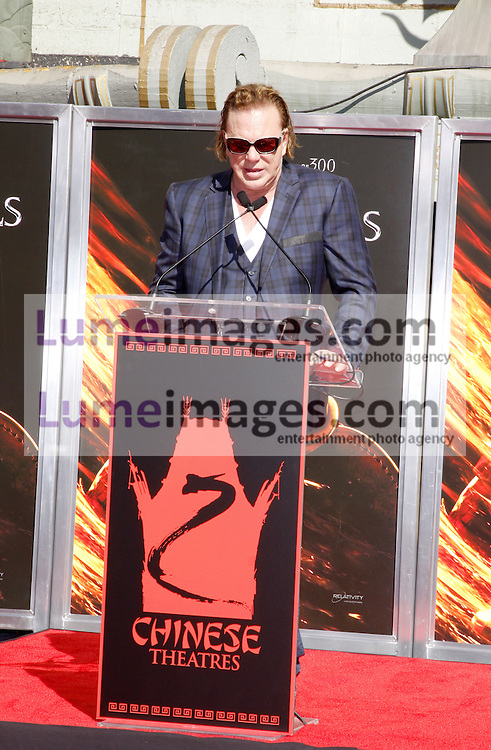 HOLLYWOOD, CA - OCTOBER 31, 2011: Mickey Rourke Hand And Footprint Ceremony held at Grauman's Chinese Theater in Hollywood, USA on October 31, 2011.