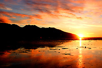 Winter sunset over Chickaloon Bay south of Anchorage Alaska.