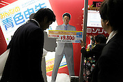 businessmen sales clerks working on a sales window display at Big Camera Tokyo Ginza Yurakucho