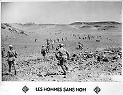The Men Without Names:  Early 20th century postcard of members of the French Foreign Legion in action. Military, Army, Soldier, Infantry, Weapon, Rifle