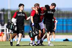 Antoine Semenyo of Bristol City is helped by Andrew Proctor and Andy rolls during the 2nd leg of the match after the previous day's game was abandoned at half time due to extreme weather - Rogan/JMP - 14/07/2019 - IMG Academy, Bradenton - Florida, USA - Bristol City v Derby County - Pre-Season Tour Day 3.