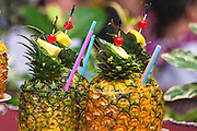 Pinapple drinks being served at a Luau in Hawaii