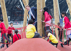 Prince Harry today joined Mayor of London Boris Johnson at the Olympic Park, London, United Kingdom. They officially opened a new playground for children and enjoyed some of the play obstacles on offer. Friday, 4th April 2014. Picture by i-Images<br /> <br /> Picture shows: Prince Harry on the rope bridge.