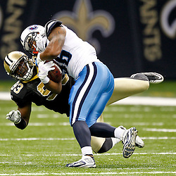 September 1, 2011; New Orleans, LA, USA; Tennessee Titans running back Herb Donaldson (36) is tackled by New Orleans Saints defensive end Junior Galette (93) during the second quarter of a preseason game at the Louisiana Superdome. Mandatory Credit: Derick E. Hingle
