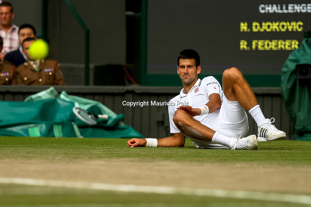 LONDON, ENGLAND - JULY 6: Novak Djokovic of Serbia watches ball go past him from the floor during the Gentlemens' Singles final match against Roger Federer of Switzerland on day thirteen of the Wimbledon Lawn Tennis Championships at the All England Lawn Tennis and Croquet Club at Wimbledon on July 6, 2014 in London, England.