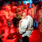 Couple kissing at a teenage disco in London Teenage kiss at School Days disco in Hammersmith, West London