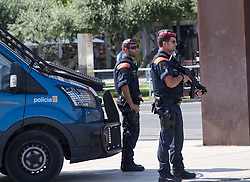 (170818) -- CAMBRILS (SPAIN), Aug. 18, 2017 (Xinhua) -- Police officers stand guard near the beach in Cambrils, Spain, on Aug. 18, 2017. At least 14 died in Thursday's double terror attacks in Spain, as Spanish people demonstrated defiance and condolences by leaders of the world poured in on Friday. (Xinhua/Xu Jinquan)  (Photo by Xinhua/Sipa USA)