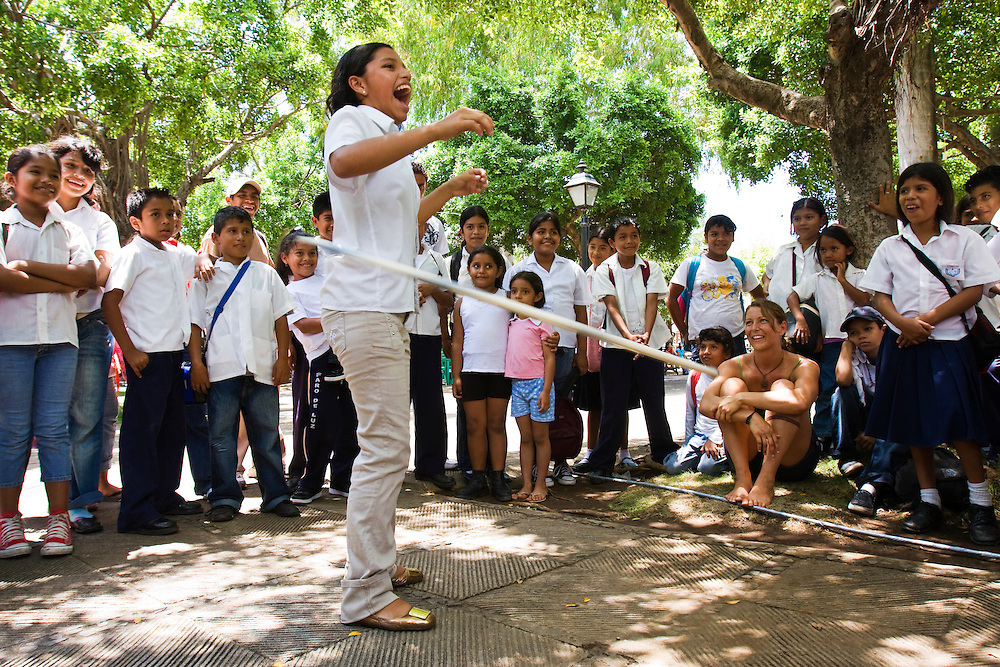 School children learn to use a hula hoop in the town square after school in the town square before going home. Granada, Nicaragua. Granada is Nicaragua's most famous city. founded in 1524 it is one of best examples of Spanish colonial architecture in the Americas. .it has a varied history including its almost total destruction by filibuster William Walker in a childlike tantrum. Today it is a popular tourist town though retains a strong sense of its own identity.