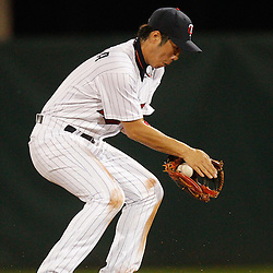February 27, 2011; Fort Myers, FL, USA; Minnesota Twins second baseman Tsuyoshi Nishioka (1) scoops up a ground ball during a spring training exhibition game against the Boston Red Sox at Hammond Stadium.  Mandatory Credit: Derick E. Hingle