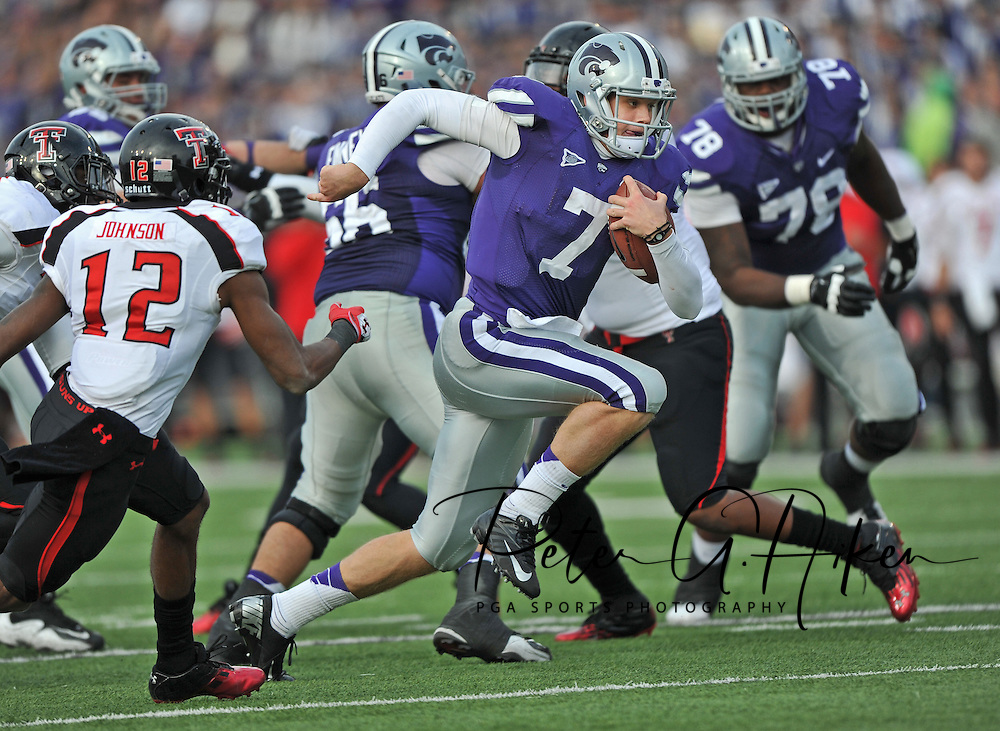 Sports Illustrated -- Quarterback Collin Klein #7 of the Kansas State Wildcats rushes up the middle for a 22-yard touchdown past defender D.J. Johnson #12 of the Texas Tech Red Raiders during the third quarter at Bill Snyder Family Stadium in Manhattan, Kansas.  Kansas State defeated Texas Tech 55-24.