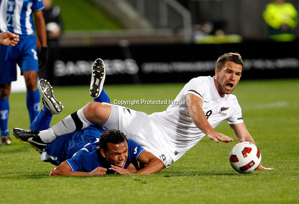 NZ's Tim Brown and Honduras's Emil Martinez collide. ASB International Series, All Whites v Honduras, North Harbour Stadium Albany, Saturday 9th October 2010. Photo: Shane Wenzlick