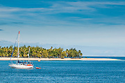 Little sailing boat in the blue lagoon, Yasawas, Fiji, South Pacific