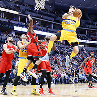 18 November 2016: Denver Nuggets forward Danilo Gallinari (8) goes to the basket over Toronto Raptors guard Kyle Lowry (7) and Toronto Raptors forward Patrick Patterson (54) during the Toronto Raptors 113-111 OT victory over the Denver Nuggets, at the Pepsi Center, Denver, Colorado, USA.