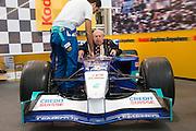 Photokina 2004, World's biggest fair for photography and imaging. Kodak souvenir photo stand with a Sauber Formula 1 race car.