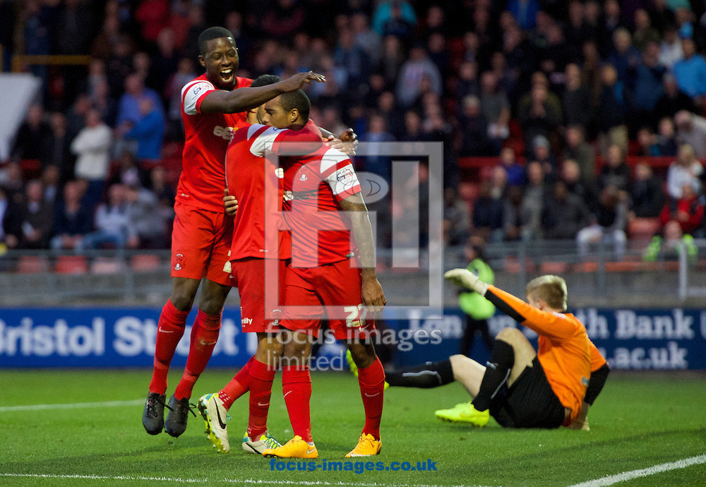 Jay Simpson (27) of Leyton Orient celebrates his goal with Jobi McAnuff (middle) and Marvin Bartley (left) during the Sky Bet League 1 match at the Matchroom Stadium, London<br /> Picture by Alan Stanford/Focus Images Ltd +44 7915 056117<br /> 01/11/2014