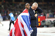 Mo Farah of Great Britain celebrates winning the 3000m during the Sainsbury's Anniversary Games at the Queen Elizabeth II Olympic Park, London, United Kingdom on 24 July 2015. Photo by Phil Duncan.