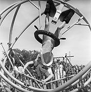 Girl hanging on a gyroscope, at Glastonbury, 1989.