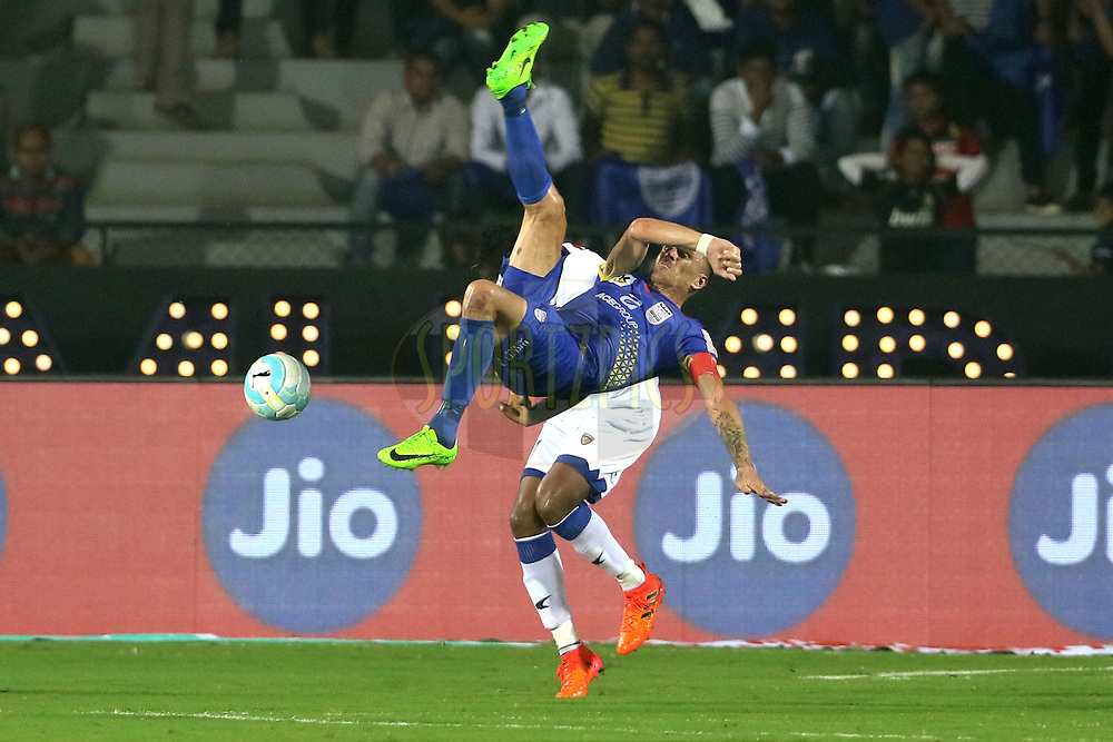 Lucian Goian of Mumbai City FC tries to kick the ball during match 22 of the Hero Indian Super League between Mumbai City FC and Chennaiyin FC  held at the Mumbai Football Arena, Mumbai India on the 10th December 2017<br /> <br /> Photo by: Vipin Pawar  / ISL / SPORTZPICS