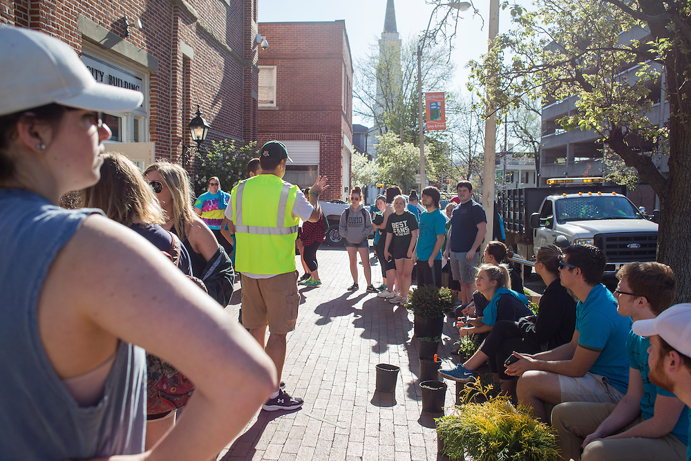 Groups of volunteers wait outside of the City Hall building to find out what work they will be assigned to do during Athens Beautification Day on April 17, 2016.