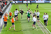 Leeds United players warming up before the EFL Sky Bet Championship match between Bristol City and Leeds United at Ashton Gate, Bristol, England on 9 March 2019.