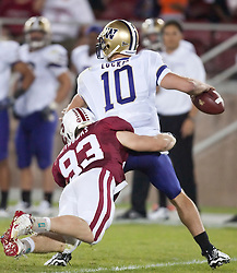 September 26, 2009; Stanford, CA, USA; Stanford Cardinal defensive end Chase Thomas (93) puts pressure on Washington Huskies quarterback Jake Locker (10) in the fourth quarter at Stanford Stadium.