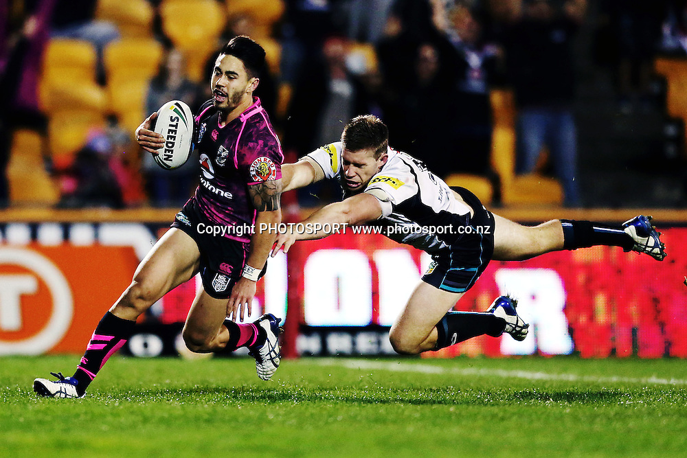 Shaun Johnson of the Warriors runs in the intercept try against Jeremy Latimore of the Panthers. Round 16 NRL Telstra Premiership game, Vodafone Warriors v Penrith Panthers, Mt Smart Stadium, Auckland, New Zealand. Sunday 29th June 2014. Photo: photosport.co.nz
